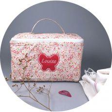 trousse-de-toilette-bebe-fleuri-rose